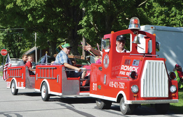 The Romick fire engine takes people on a ride around the Fryburg Homecoming festival Sunday, Sept. 2.