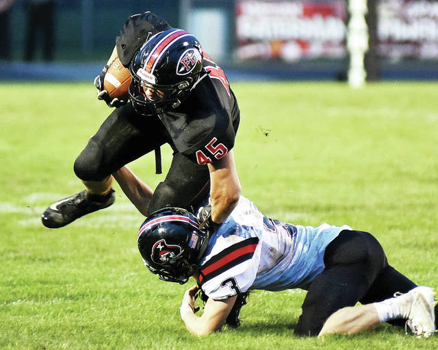 Fort Loramie sophomore running back Max Hoying runs while trying to dodge a Covington defender during a Cross County Conference game last Friday. The Redskins will travel to Miami East for a CCC showdown this Friday.