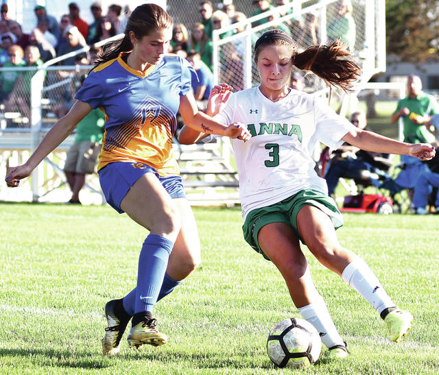 Anna's Taylor Kauffmann and Lehman Catholic's Anna Cianciolo jostle for position during a Western Ohio Soccer League match on Thursday in Sidney.