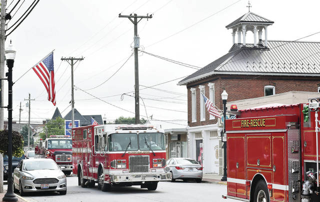 A funeral procession for retired Botkins firefighter Ed Burden led by Botkins fire engines drives past the Botkins fire house Friday, Sept. 14. Burden was a 40-year veteran of the Botkins Fire Department. Burden died Monday, Sept. 10. Mass of Christian Burial was held at Immaculate Conception Church Friday morning. The Shelby County Sheriff's Office dispatcher did a final call for service over the department's airwaves in Burden's honor at the end of the service.