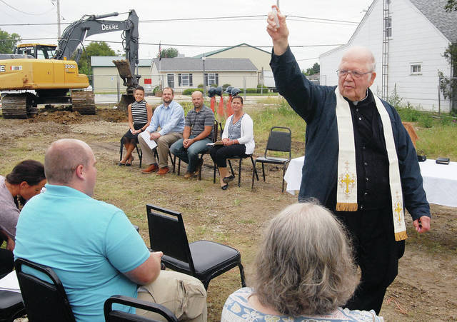 The Rev. Charles Mullen, of Carthagena, blesses the audience attending the groundbreaking of The Do Good Restaurant and Ministry in Osgood Wednesday, Sept. 12.