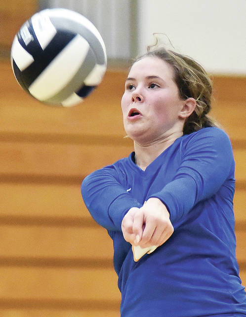 Russia's Kendall Monnin gets under a ball during a nonconference match against Lehman Catholic on Saturday in Sidney.