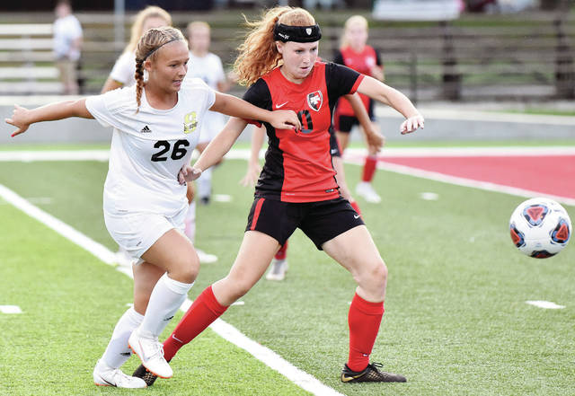 Sidney's Khia McMillen and Tippecanoe's Kearsten Hill jockey for control during a Greater Western Ohio Conference American North Division game on Wednesday in Tipp City Park. The Yellow Jackets lost 4-0.