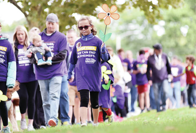 Aida Borchers, 10, of Russia, daughter of A.J. and Katie Borchers, takes part in the Walk to End Alzheimer's Saturday, Sept. 22. Borchers walked with the team Boots Scootin' Boogie which was named for her great grandma Ruth Anne Meyer whose nickname is Boots. The walk began on the courtsquare after a short program promoting an end to Alzheimer's.
