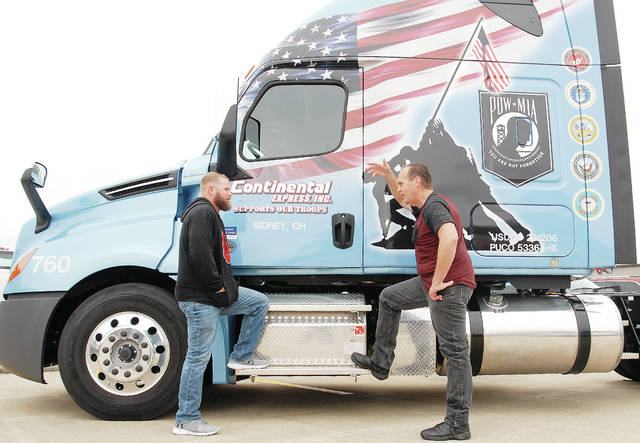 Kevin Hatton, left, of Troy, and Daniel Kleman, of Delphos, were honored Saturday, Sept. 22, at Continental Express, Inc. for both driving one million miles without an accident.