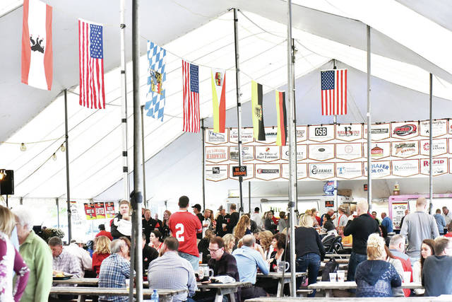 People enjoy German food and music at Fort Loramie German Heritage Days Saturday, Sept. 22.