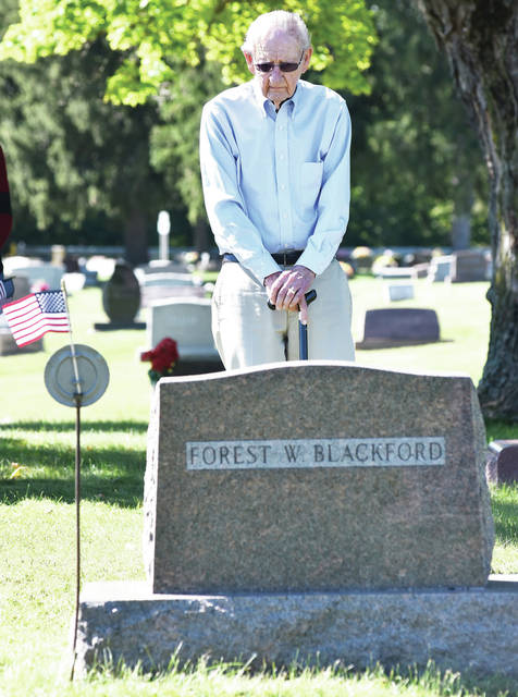 Virgil Mills, of Kent, Wash., visits the grave of his Korean War platoon leader, Forest Blackford, at Cedar Point Cemetery, in Pasco, Sunday, Sept. 23.