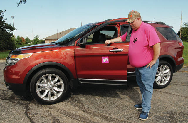 Cy Baber, of Sidney, with his Lyft vehicle.