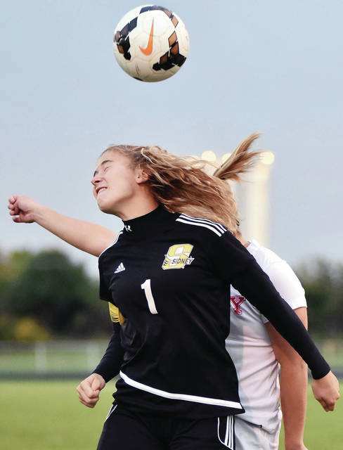 Sidney's Elaine Wiesenmayer and Troy's Josalyn Abrams go up for a header during a Greater Western Ohio Conference American North Division game on Saturday in Sidney.