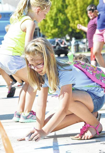 Rosaline Case, of Minster, daughter of Tiffany Case and Jerry Dudgeon, competes in the Kids Sidewalk Chalk Contest at the 2017 New Bremen Pumpkinfest.