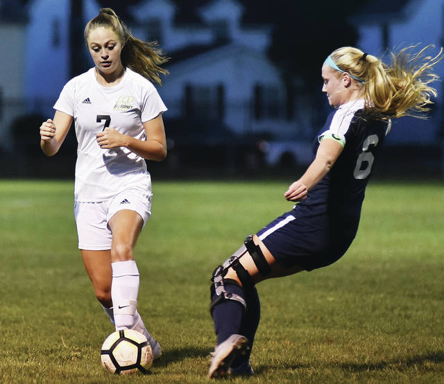 Sidney's Katie Atwood is confronted by Piqua's Hailey McPherson during a Greater Western Ohio Conference match on Wednesday at Wertz Stadium in Piqua.