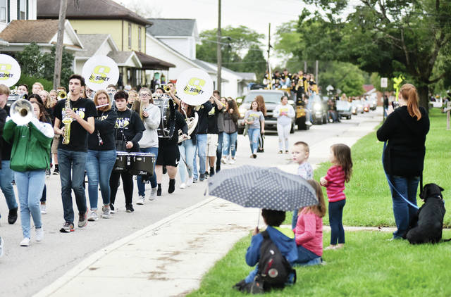The Sidney High School marching band takes part in the Sidney High School homecoming parade Thursday, Sept. 27.