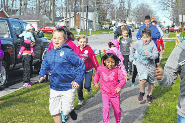 Children enjoy a fun run during the Sidney-Shelby County YMCA's Healthy Kids Day in April. The YMCA has announced several upcoming programs, open to the public, aimed at ending childhood obesity.