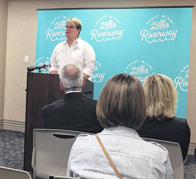 Elizabeth Connor, Great Miami Riverway coordinator, speaks to several officials from communities along the Great Miami River at the Miami Conservancy District in Dayton Monday morning, Sept. 10, about results of a 2017 economic impact study of the riverway. The study reveals the Great Miami Riverway brings in big money and sustains jobs.