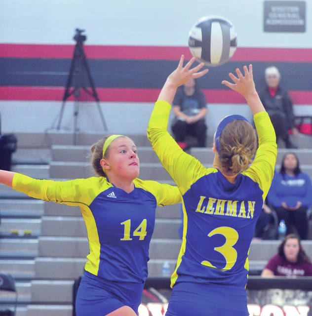 Lehman's Alexis Snipes, 3, sets the ball for Abby Schutt, 14.