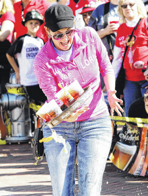 Luke Gronneberg | in75 file photo Steph Goldstein, of Troy, drops her tray during the beer tray relays at Minster Oktoberfest Saturday, Sept. 30.