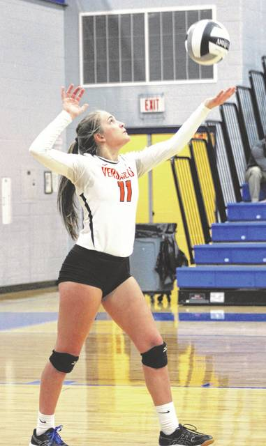 Abby Stammen (11) serves in the second set during Versailles' Division III district semifinals win over the Northeastern Jets on Thursday at Brookville. The Tigers play in the district championship at 4:30 p.m. on Saturday against Cincinnati Hills Christian Academy.