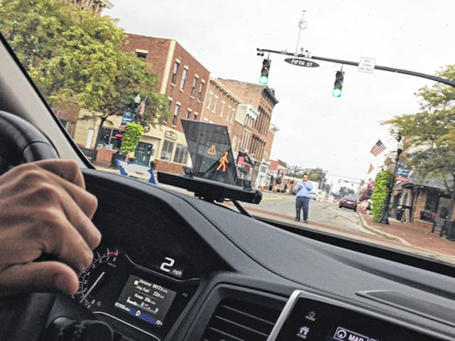 "The little screen on the dashboard alerts the driver that a pedestrian will be in his path when he turns the corner. The technology of the ""smart intersection"" was unveiled in Marysville by Honda R&D Americas Inc., Thursday, Oct. 4."