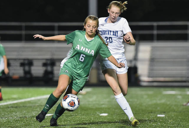 Anna's Kelsie McKinney stays in front of Cincinnati Country Day's Sarah Zimmerman during a Division III regional semifinal on Tuesday in Beavercreek.