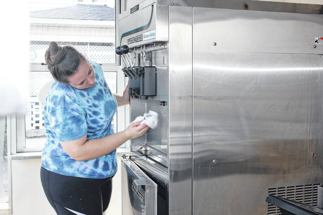 Chilly Jilly's assistant manager Jackie Fishbaugh, of Anna, cleans the ice cream machine Tuesday. The ice cream parlor closed for the season on Sunday, so everything is being cleaned and put away until it reopens around St. Patrick's Day in 2019.