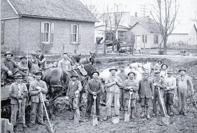 In 1916, this group of men were digging the foundation for the New Knoxville United Methodist Church.