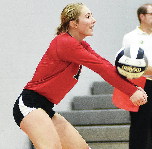 Fort Loramie senior libero Emily Austin bumps during a Division IV sectional final against Franklin-Monroe on Wednesday in Covington.