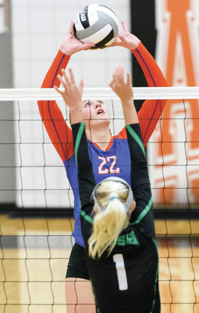 Riverside senior Shelby Giles sets during a Division IV sectional semifinal against Springfield Catholic Central last season at Ansonia. Giles was named first team all-NWCC.
