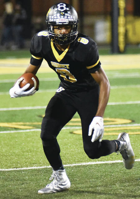 Sidney junior wide receiver Ratez Roberts runs after a catch during a Greater Western Ohio Conference game gainst Piqua on Sept. 28. Roberts leads the Yellow Jackets in receptions (23) and is second in receiving yards (256).