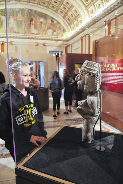 Katelyn Kinsella checks out the Tlaloc, the Mexican God of Rain in the Library of Congress on Wednesday during the Botkins eighth-grade class trip to Washington, D.C. The eighth-graders will return to Ohio on Saturday.