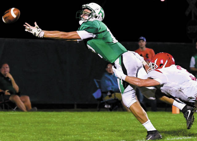 Anna's Jeffrey Richards tries to catch a pass with pressure from St. Henry's Cody Bruggeman during a Midwest Athletic Conference game on Sept. 14 in Anna. Richards is tied for first in the MAC with five interceptions to his credit.