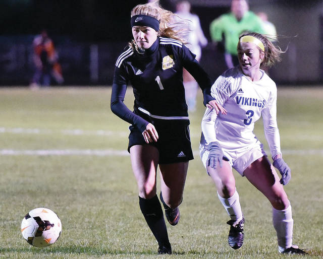 Sidney senior Elaine Wiesenmayer breaks away from Miamisburg's Sierra Weeks during a Division I sectional semifinal on Saturday in Sidney. The Yellow Jackets lost 1-0.
