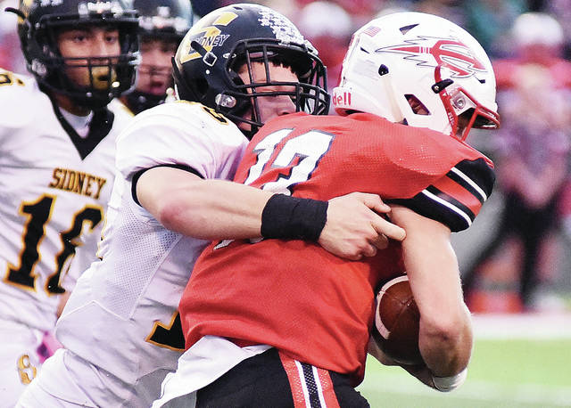 Sidney's Ryan Cagle tackles a Tippecanoe player during a Greater Western Ohio Conference American North Division game on Friday in Tipp City.