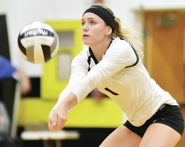 Sidney senior outside hitter Alina Kindle bumps during a Greater Western Ohio Conference American North Division match against Greenville on Thursday. Kindle had 14 kills and three blocks.