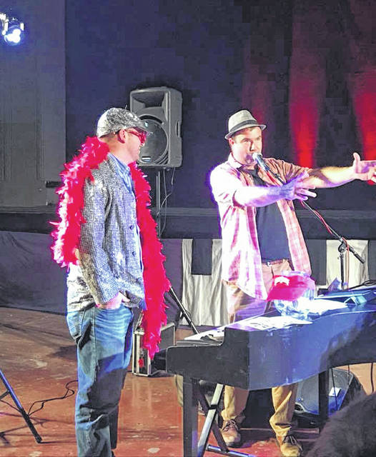 Musicians with Dueling Pianos International perform a comedy skit during a recent performance. They will appear at the Historic Sidney Theatre, Oct. 19.