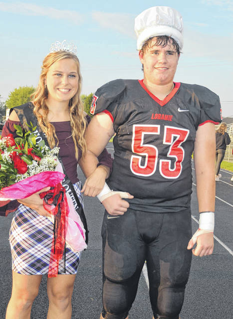Erin Chaney, left, daughter of Teresa and Dave Chaney, and Grant Imwalle, son of Connie and Joe Imwalle, reign over Fort Loramie High School homecoming activities. They were crowned queen and king, Friday, Oct. 5, before a football game with Mississinawa Valley.