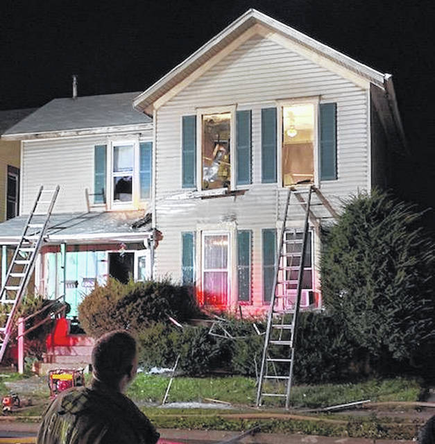 Firefighters on the scene after knocking down the main body of a two-story duplex fire at 311 S. Miami Ave. Monday, Oct. 8. The call came into the dispatch at 6:58 p.m. A box alarm was requested recalling all off duty Sidney firefighters, Anna and Lockington Fire Departments and Perry Port Salem Rescue. Five people were displaced from the fire.