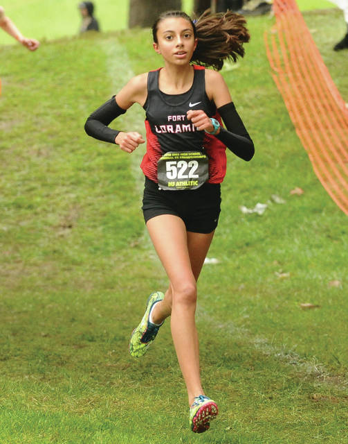 Fort Loramie freshman Olivia Borchers runs during the Division III girls regional cross country race on Saturday in Troy. Borchers finished third.
