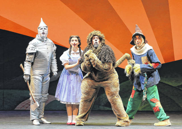 "Christopher Russell, left to right, as the Tin Man, Kalie Kaimann as Dorothy, Victor Legarreta as the Lion and Chris Duir as the Scarecrow perform in ""The Wizard of Oz,"" which will play in the Schuster Center in downtown Dayton, Oct. 23-25."
