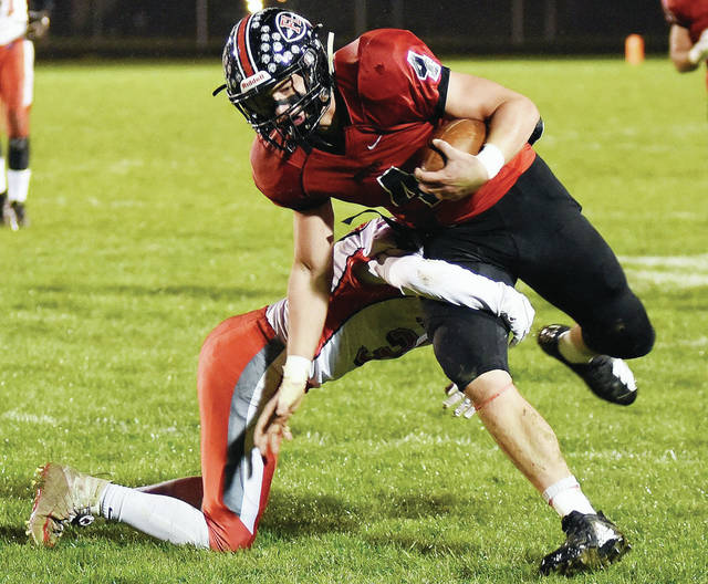 Fort Loramie's Nick Brandewie runs during a Cross County Conference game against Tri-County North on Friday in Fort Loramie. The Redskins are one of five area squads to qualify for postseason play. Steve Egbert | Sidney Daily News
