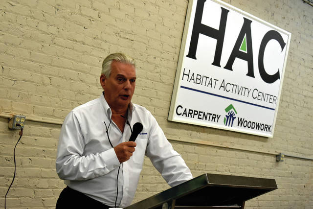 Bill Horstman, executive director and COO for HFHMSCO, thanks sponsors during the open house for the new Habitat Activity Center on Thursday in Troy.