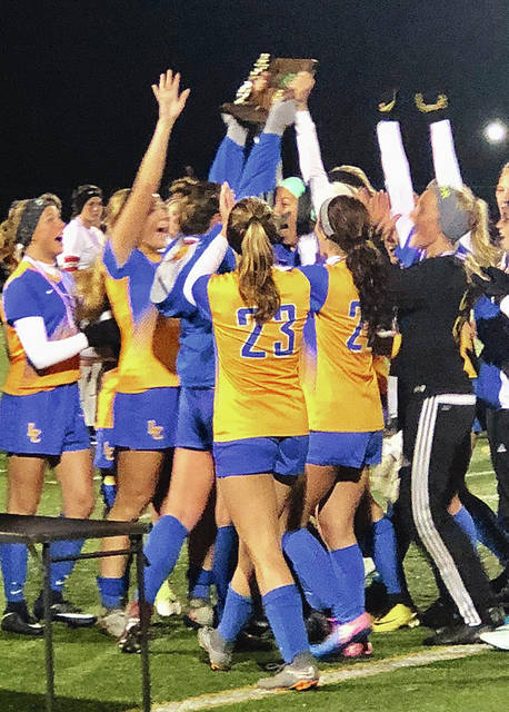 Lehman Catholic celebrates after winning a second straight district title Saturday night.