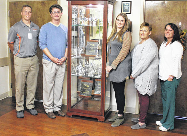 Versailles Health Care Center is now Versailles Rehabilitation and Health Care Center following acquisition of the facility by Crown Healthcare Group. Shown, from left, are Director of Rehab Stephen Winner, Director of Integrated Support T.J. Johnston-Hicks, Executive Director Lindsey Gehret, Case Manager Chris Huber and Director of Nursing Stephanie Tompkins.