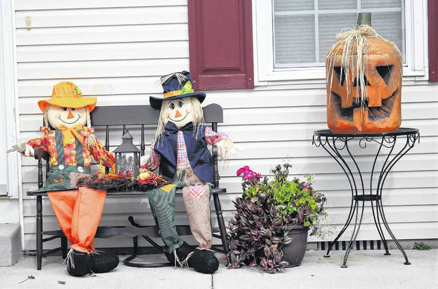 Two scarecrows and a decorated pumpkin greet visitors at a home on Kings Court in Sidney. With the first day of October behind us, residents across the county are preparing decorations for Halloween.