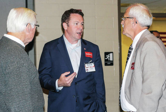 Congressman Warren Davidson, center, talks with Kent Craver, left, and Jim Liggett, both of Sidney.