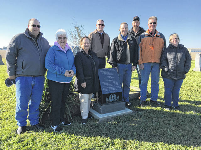 A dedication ceremony for the newest Annie Oakley historical marker, at Mendenhall Cemetery, occurred on Saturday, Oct. 20. On the left of the stone are Jeff Perry, Joan Dowler and Bonnie Perry, Annie's relations. Bonnie is also vice president of the Annie Oakley Center Foundation. Behind the stone is Steve Meier, Sidney, formerly of Yorkshire, and initiator of the idea. To the right of the stone are Ken Subler, Yorkshire mayor; Steve Puthoff and Sam Pohlman, township trustees; and Kathy Bruns, researcher.
