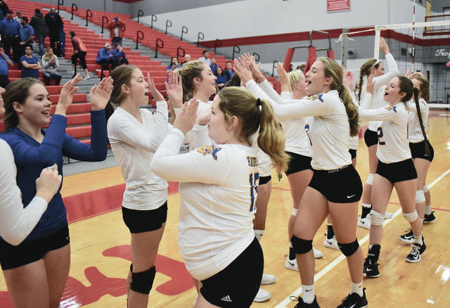 Russia players give each other high-fives after beating Southeastern in a Division IV district final on Saturday in Troy.