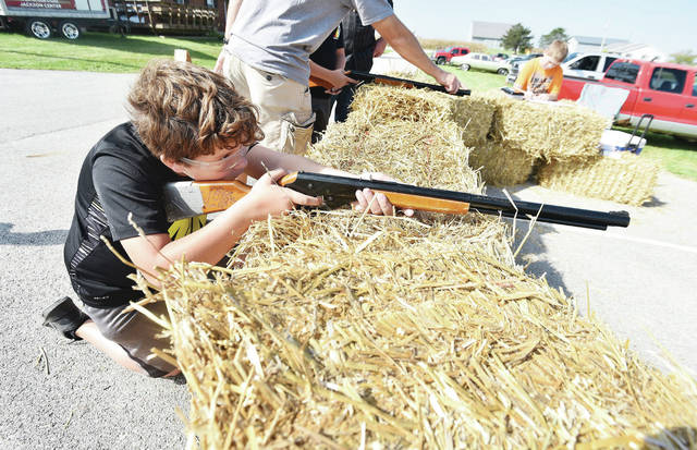 Gavin Schmerge, 11, of Botkins, son of Fred and Becky Schmerge, takes aim with a bb gun at the 47th annual Rhine Turkey Shoot Sunday, Sept. 30.