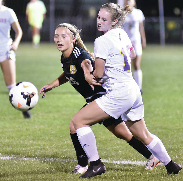 Sidney's Khia McMillen looks to get around Butler's Skylar Rose during a Greater Western Ohio Conference American North Division match on Wednesday in Sidney.