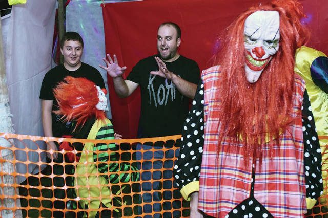 Jarrett Miller, left, 13, and his dad, Will Miller, both of Sidney, walk through the clown tent at the Chainer's Field of Screams, Saturday, Oct. 6. The haunted field is next to the Inn Between, 16488 county Road 25A, Botkins. Parking is in the rear of the Inn Between. Proceeds benefit Relay for Life of Shelby County. The field will be open Oct. 12, 13, 19, 20, from 8 p.m.