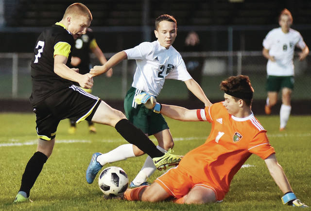 Sidney's Braden Guinther runs into Greenville goalie Jacob Maher during a Greater Western Ohio Conference American North Division game on Tuesday in Sidney. Guinther scored two goals in the second half of Sidney's 5-1 win.